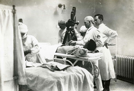 Surgery being filmed at Walter Reed Hospital, Washington, DC. Note the patient is awake and watching the preparation for surgery. 1918.