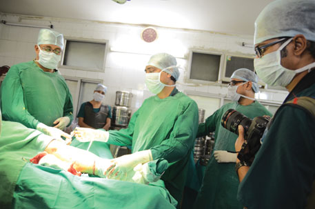 Kaushik Ghosh is ready to shoot an orthopaedic surgery (Photo: Sayantan Bera)